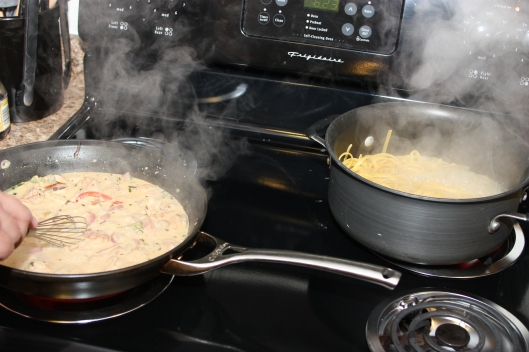cooking sauce and pasta